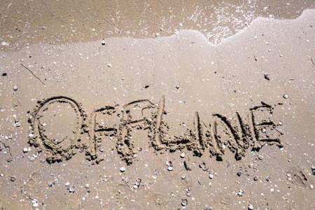 Online word is written on the beach sand