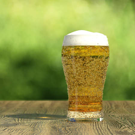 Very high resolution 3d rendering of a glass of fresh beer.