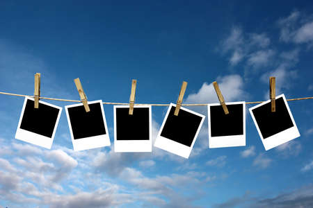 clothesline: Four photos attached to a stringe with a defocused background.
