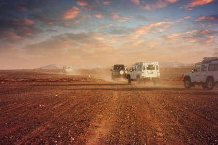 rover: Cars in the desert at sunset
