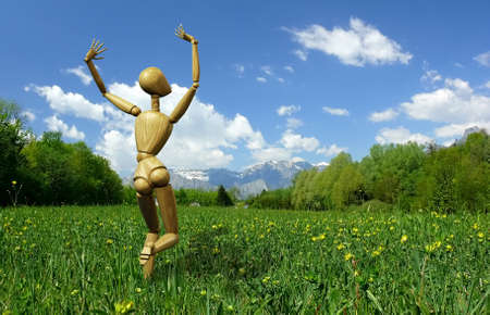 Computer generated illustration of an happy wooden mannequin running in the grass  illustration