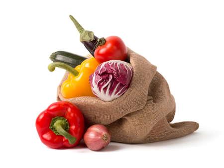 Bag of fresh vegetables isolated over white
