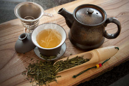 pu: Cup of green tea and accessories