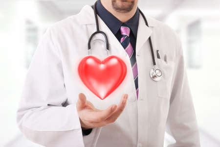 Male doctor showing a red heart photo