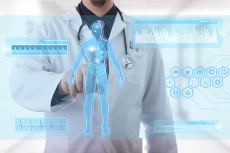 Male doctor working on a futuristic touchscreen display photo