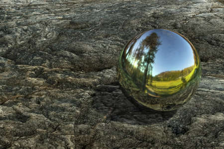 Metal ball on a stone conceptual image