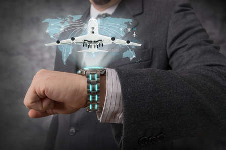 Businessman showing an hologram with his futuristic wristwatch photo