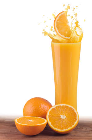 Orange juice glass and oranges witha splash of juice photo