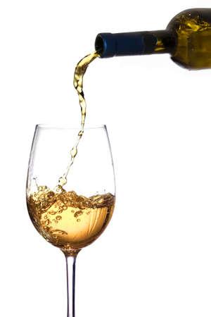 透明なガラスの中に白ワインが注がれて 写真素材
