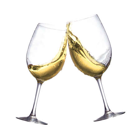 Toasting of two white wine clear glasses Standard-Bild