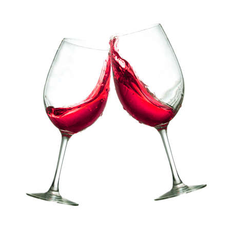 Toasting of two red wine clear glasses Banque d'images