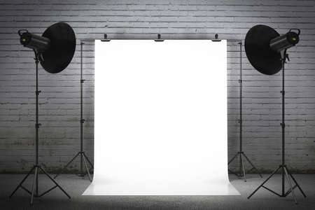 studio portrait: Professional strobe lights illuminating a backdrop