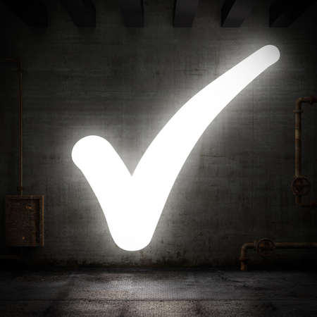 proceed: Luminous check mark in a grunge room Stock Photo