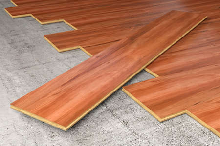 A floor being covered with hardwood planks