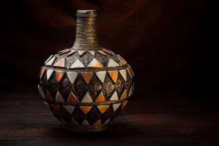Antique Moroccan vase on an old dark table Zdjęcie Seryjne