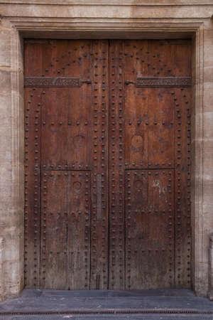 Old wooden door of an ancient church