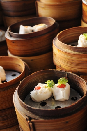 dim sum: Chinese steamed dimsum in bamboo containers traditional cuisine