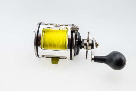 fishing reel: used  fishing reel. Isolated on white background