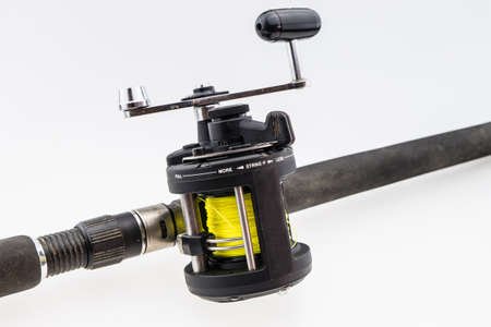wobler: fishing-rod with spinning-wheel on white background