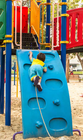 jungle gyms: Kid playing outdoor