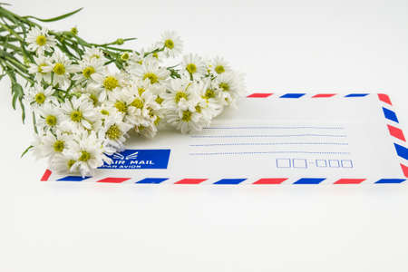 air mail: Air mail envelope with white cutter flower. White Backgound Stock Photo