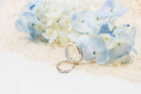 wedding ring with blue hydrangea on  ivory lace Stok Fotoğraf