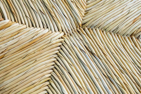 Weave pattern rattan background.Woven rattan with natural patter photo
