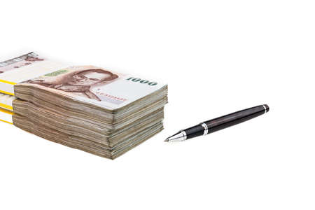 ball pens stationery: Black pen and Thailand money banknotes stacked isolated