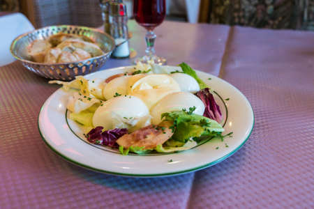 stuffed eggs with mayonnaise in plate photo