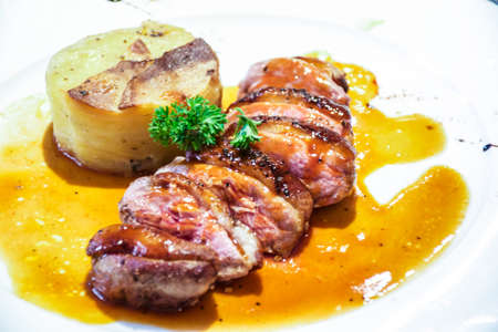 masses: Duck steak with and masses potatoes on a plate on restaurant Stock Photo