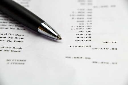 bank statement: Pen on Bank statement