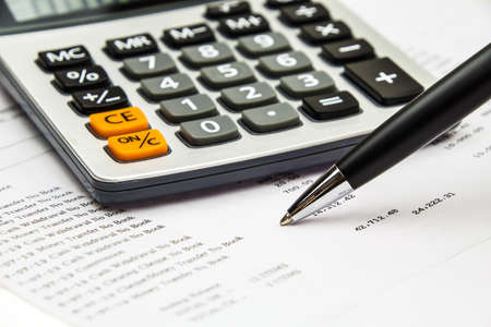 bank statement: Pen point on bank statement with calculator