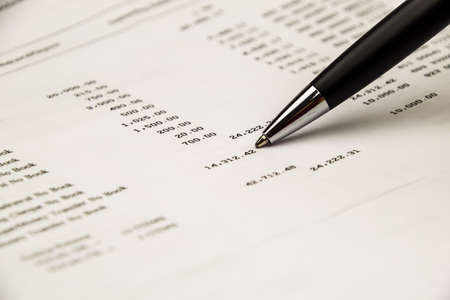 Pen point on Bank statement