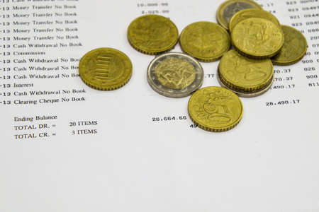 bank statement: Bank statement and Euro coin Stock Photo