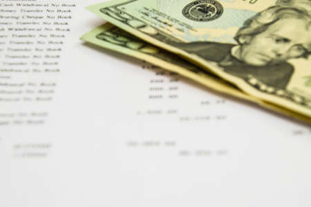 finacial: Bank statment with dollar note Stock Photo