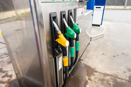 filling in: Petrol pump filling in gas station