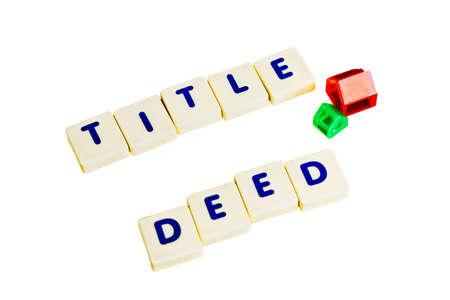 deeds: Title deed text  scrabble Stock Photo