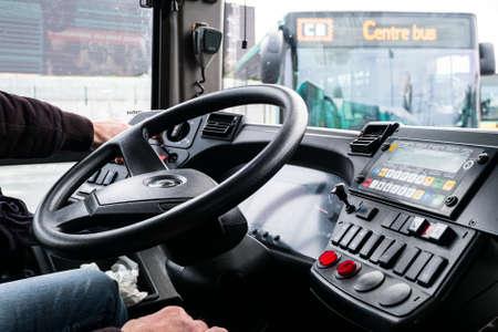 Bus driver in the back of steering wheel. Standard-Bild