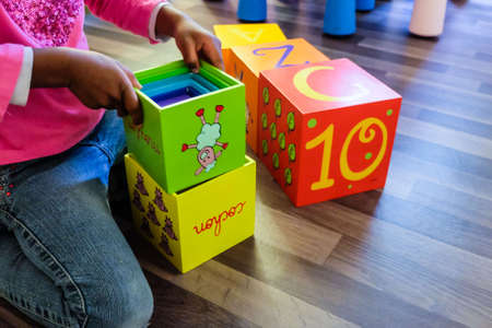 toy box: Girl playing wooden toy box