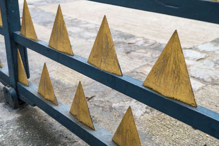 metal fence: Gold triangle metal fence. Stock Photo