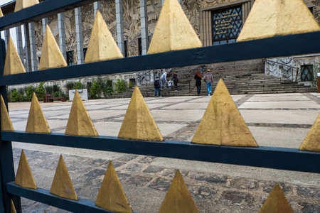 gold metal: Gold triangle metal fence. Stock Photo