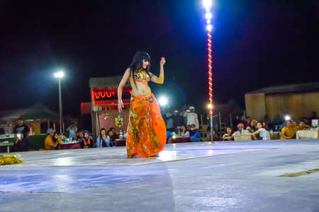 sexy girl dance: Dubai, United Arab Emirates -November 6, 2015: beautiful belly dancer performing a Belly Dance.