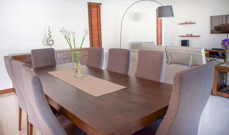 wooden dinning table with grey chair in living room.