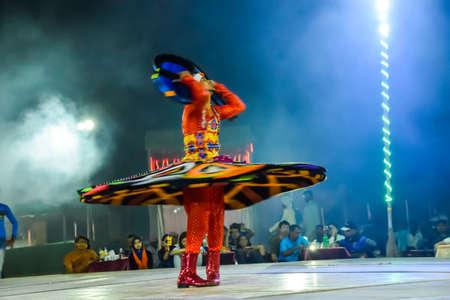 Dubai, United Arab Emirates - November 6, 2015: Arab dancer performing a turning dance.