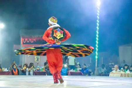 Dubai, United Arab Emirates - November 6, 2015: Arab dancer performing a turning dance.