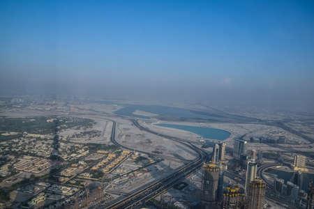 Dubai, United Arab Emirates -November 5, 2015: Aerial view of Downtown Dubai shooting through the glass window  from the tallest building in the world  , Burj Khalifa