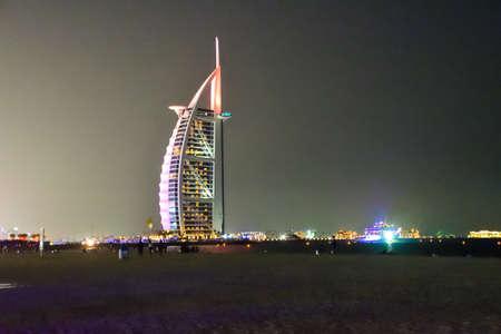 Dubai, United Arab Emirates -November 7,2015: Burj Al Arab the luxury seven star Dubai hotel view  in the night  from Jumeirah Beach Editorial