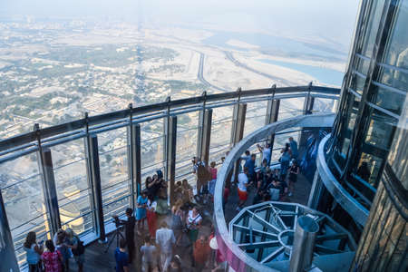 Dubai, United Arab Emirates -November 5, 2015: tourists looking Aerial view of Downtown Dubai  from the tallest building in the world, Burj Khalifa Editorial
