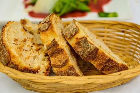 slice french bread in basket.