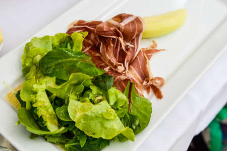 melon, prosciutto and salad.